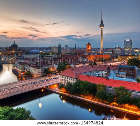 Berlin, Germany rooftop view on Television Tower, Berlin Cathedral, Rotes Rathau and the River Spree - the major landmarks at late sunset - stock photo