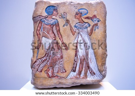 BERLIN, GERMANY - SEPT 2: Pharaoh and his wife from 14th century BC on stone egyptian relief on September 2, 2015. Ancient Egyptian collection is part of Neues Museum in Berlin - stock photo