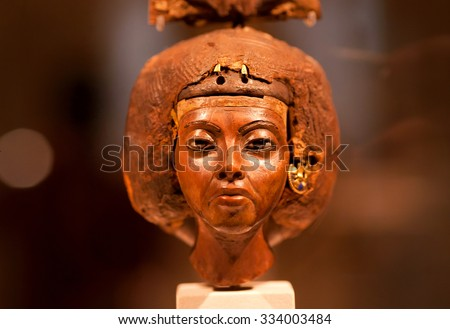 BERLIN, GERMANY - SEPT 2: 14th century BC head of statuette of queen Tiy with feather crown in Egyptian Museum on September 2, 2015. Ancient Egyptian collection is part of Neues Museum in Berlin - stock photo