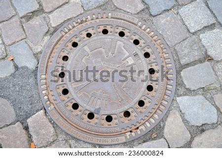 BERLIN, GERMANY - SEPTEMBER 14: manhole Berlin on SEPTEMBER 14, 2013, Berlin,  - stock photo