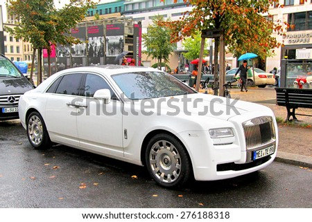 BERLIN, GERMANY - SEPTEMBER 11, 2013: Modern luxury car Rolls-Royce Ghost at the city street near the hotel. - stock photo
