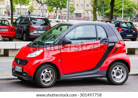 BERLIN, GERMANY - SEPTEMBER 11, 2013: Motor car Smart City Coupe at the city street. - stock photo