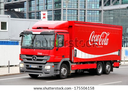 BERLIN, GERMANY - SEPTEMBER 10, 2013: Red Coca-Cola Mercedes-Benz Actros 2541 truck at the city street. - stock photo