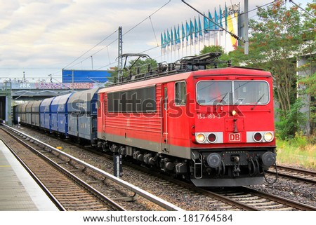 BERLIN, GERMANY - SEPTEMBER 10, 2013: Red DB freight train at the railway. - stock photo