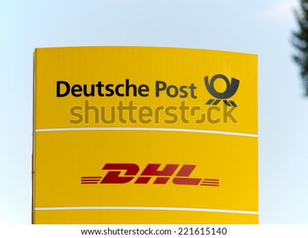 BERLIN, GERMANY - SEPTEMBER 18: the logo of the brands Deutsche Post and DHL at a delivery point. Deutsche Post DHL is the world's largest courier company.  Berlin, Germany, Europe, sept 18 2014  - stock photo
