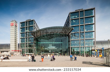 BERLIN - GERMANY - SEPTEMBER 29, 2014; Tourists with their luggage going to or from the main railway station in Berlin, Germany (Berlin Hauptbahnhof). Berlin, Germany, September 29, 2014 - stock photo
