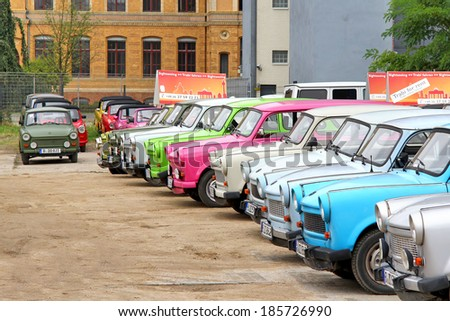 BERLIN, GERMANY - SEPTEMBER 12, 2013: Trabant retro vehicles at the parking of the Trabi Safari touristic service. - stock photo