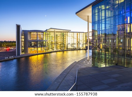Berlin government buildings and Bundeskanzleramt the German chancellery illuminated at night and reflected in the river Spree, Berlin, Germany. - stock photo