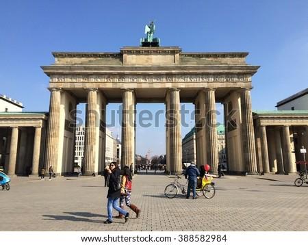 Berlin,Grrmany- March 9,2016: Tourist walking near famous Branderburger Tor(Branderburger Gate) - stock photo
