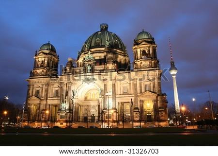 Berlin: Illuminated Berliner Dom and TV tower, Germany - stock photo