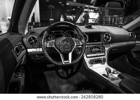 BERLIN - JANUARY 24, 2015: Showroom. Cabin of a sports car Mercedes-Benz SL500 (R231). Black and white. Produced since 2012. - stock photo