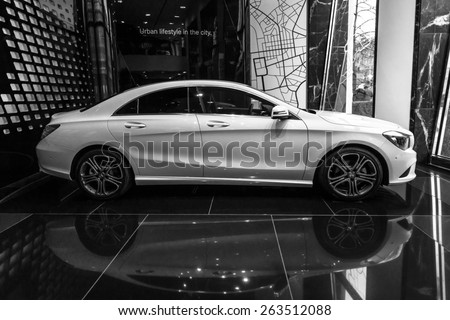 BERLIN - JANUARY 24, 2015: Showroom. Compact executive car Mercedes-Benz CLA200. Black and white. Produced since 2013. - stock photo