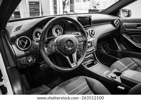 BERLIN - JANUARY 24, 2015: Showroom. Interior of a compact car Mercedes-Benz A200 CGI BE. Black and white. Produced since 2013.