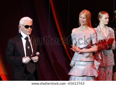 BERLIN - JULY 19: Claudia Schiffer and Karl Lagerfeld attends the Elle Fashion Star 2008 at the Tempodrom. July 19, 2008 in Berlin. - stock photo