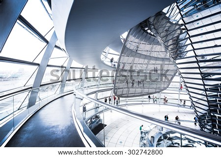BERLIN - JULY 19: Interior view of famous Reichstag Dome on July 19, 2015 in Berlin, Germany. Constructed to symbolize the reunification of Germany it's now one of Berlin's most important landmarks. - stock photo