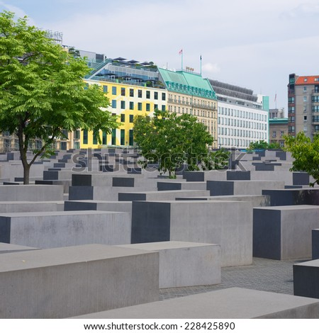 BERLIN - JULY 27, 2014: Jewish holocaust memorial. This place consist of 2,711 concrete blocks in different sizes placed on 19.000 square meters area. - stock photo