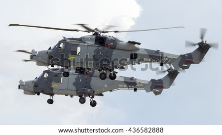 BERLIN - JUN 2, 2016: AgustaWestland AW159 Wildcats (improved Super Lynx) performing flying backwards at the Berlin Airshow ILA on Berlin-Schoneveld airport - stock photo