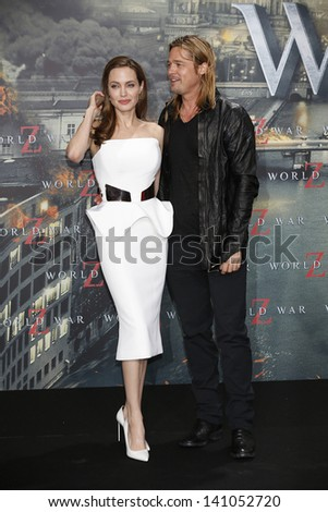 BERLIN - JUN 4: Angelina Jolie and Brad Pitt at the 'WORLD WAR Z' Premiere at Sony Center on June 4, 2013 in Berlin, Germany - stock photo