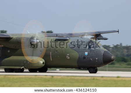 BERLIN - JUN 2, 2016: German Air Force C-160 Transall transport plane landing during a demonstration at the Berlin Airshow ILA on Berlin-Schoneveld airport - stock photo