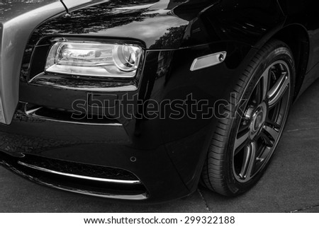 BERLIN - JUNE 14, 2015: Fragment of the full-size luxury car Rolls-Royce Wraith (since 2013). Black and white. The Classic Days on Kurfuerstendamm. - stock photo