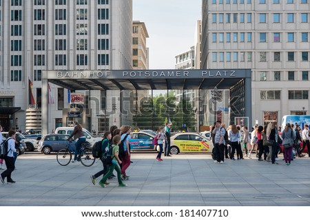 BERLIN - JUNE 4, 2013: People in front of Potsdamer Platz station. The Berlin U-Bahn is the most extensive underground network in Germany with a system length of 146 km.  - stock photo