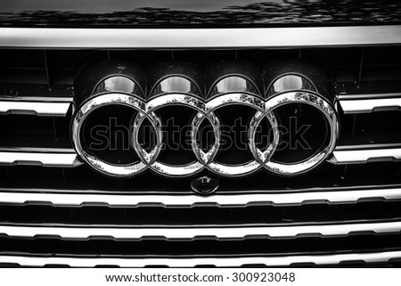 BERLIN - JUNE 14, 2015: The emblem on the front grille of a full-size luxury crossover SUV Audi Q7 3.0 TDI quattro. Black and white. The Classic Days on Kurfuerstendamm. - stock photo