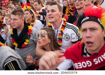 BERLIN - JUNE, 22: Unknown german fans celebrating football game on Euro 2012 near Brandenburger Tor. June 22, 2012 in Berlin, Germany - stock photo