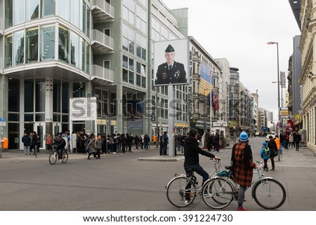 "BERLIN, 15 MARCH: Former bordercross ""Check Point Charlie"" in Berlin on March 15, 2016. It's the best-known Berlin Wall crossing point between East and West Berlin during the Cold War. - stock photo"