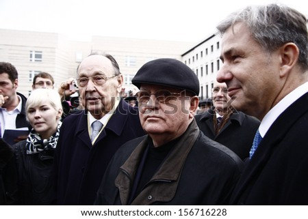 BERLIN -  MARCH 13, 2009 : Michail Gorbachev, Hans-Dietrich Genscher, Klaus Wowereit - meeting of the former Soviet leader with the former German Foreign Minister at the Brandenburg Gate in Berlin.