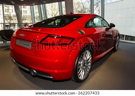 BERLIN - MARCH 08, 2015: Showroom. Sports car Audi TT 2.0 T quattro (2014). Audi AG  is a German automobile manufacturer.