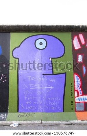 BERLIN - MARCH 06: The East Side Gallery is under worldwide  protest in terms of the removal of several  Berlin Wall segments  to allow the construction of a luxury hotel in  MARCH 06, 2013 in Berlin.