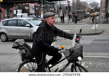 BERLIN MARCH 6: Unidentified male riding the bicycle (over 15% people in Berlin prefer moving by bike) on March 6, 2015. - stock photo