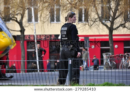 BERLIN - March 3: Unidentified policeman controls the situation during knifing accident on March 3, 2015 in Berlin, Germany.