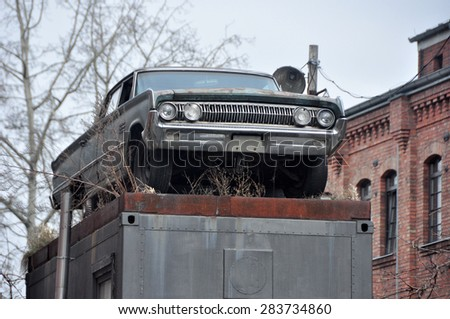 BERLIN MARCH 6:  Vintage car on the pedestal in Eastern Berlin on March 6, 2015. - stock photo