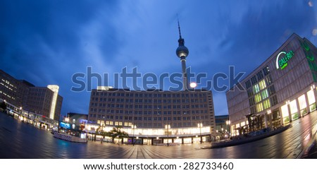 BERLIN - MAY 10, 2015: Alexanderplatz at dusk. Alexanderplatz is a large square and transport hub, named in honor of a visit of the Russian Emperor Alexander I. - stock photo