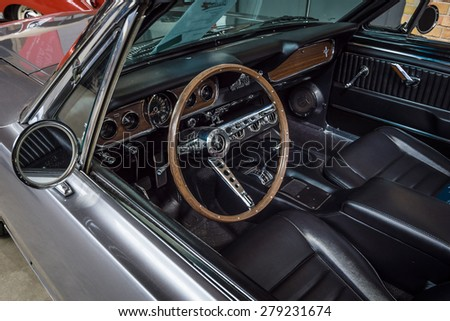 BERLIN - MAY 10, 2015: Cab of a pony car Ford Mustang (first generation). 28th Berlin-Brandenburg Oldtimer Day - stock photo