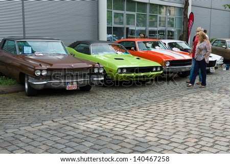 BERLIN - MAY 11: Cadillac de Ville, Dodge Challenger and Chevrolet Chevelle SS coupe, 26. Oldtimer-Tage Berlin-Brandenburg, May 11, 2013 Berlin, Germany - stock photo