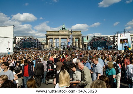 BERLIN - MAY 23: Crowd enjoy the party at the Brandenburger Gate during 60 years anniversary of German foundation celebration May 23, 2009 in Berlin, Germany. - stock photo