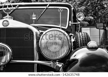 BERLIN - MAY 11: Detail of the car Mercedes-Benz 320 (W142) black and white, 26th Oldtimer-Tage Berlin-Brandenburg, May 11, 2013 Berlin, Germany - stock photo