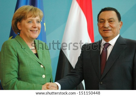 BERLIN - MAY 10: Egyptian President Hosni Mubarak shakes hands with German Chancellor Angela Merkel  during a meeting in the German Chanclery in Berlin, MAY 10, 2006. - stock photo
