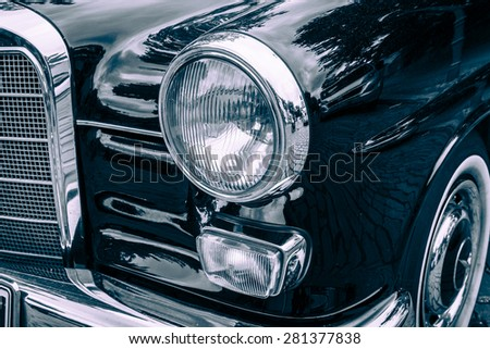 BERLIN - MAY 10, 2015: Fragment of a executive car Mercedes-Benz 190Dc (W110), 1964. Stylization. Vintage toning. 28th Berlin-Brandenburg Oldtimer Day