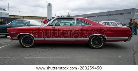 BERLIN - MAY 10, 2015: Full-size car Ford Galaxie 500 / XL. Side view. 28th Berlin-Brandenburg Oldtimer Day - stock photo