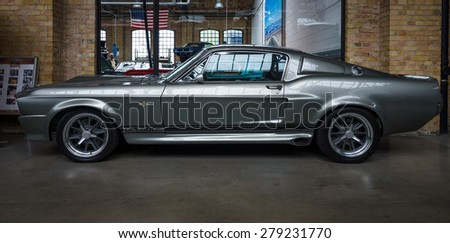 BERLIN - MAY 10, 2015: Shelby GT 500E Super Snake, 1968. The Shelby is a higher performance variant of the Ford Mustang. 28th Berlin-Brandenburg Oldtimer Day - stock photo