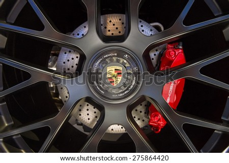 BERLIN - MAY 02, 2015: Showroom. Wheels and braking system of a sports car Porsche 911 Targa 4 GTS. Produced since 2014. - stock photo
