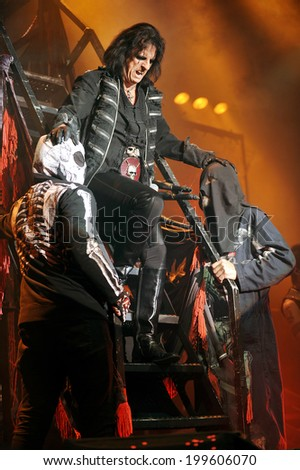 BERLIN - NOVEMBER 14: Legendary American rocker Alice Cooper (in the middle) during his performance in Berlin, Germany, November 14, 2011. - stock photo