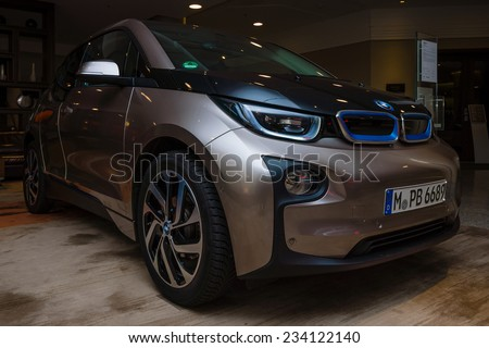 BERLIN - NOVEMBER 28, 2014: Showroom. The BMW i3, previously Mega City Vehicle (MCV), is a five-door urban electric car developed by the German manufacturer BMW. - stock photo