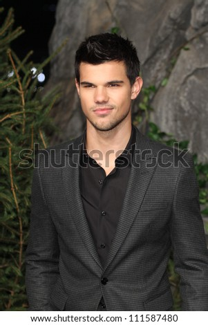 BERLIN - NOVEMBER 18: Taylor Lautner attends the Germany Premiere of 'The Twilight Saga: Breaking Dawn Part 1 on November 18, 2011 in Berlin, Germany. - stock photo