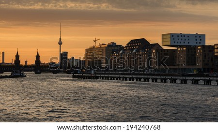 Berlin oberbaumbrucke with tv tower at sunset - stock photo