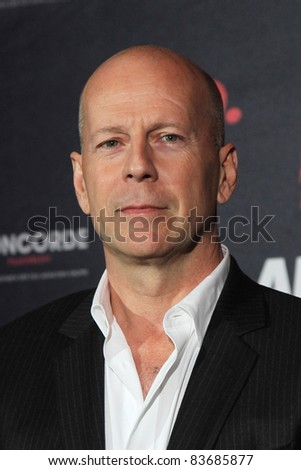 BERLIN - OCTOBER 18: Actor Bruce Willis attends a photocall presenting the movie RED at Regent Hotel on October 18, 2010 in Berlin, Germany.