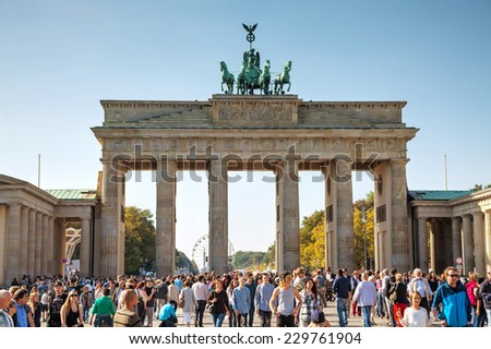 BERLIN - OCTOBER 4: Brandenburg gate (brandenburger tor) on October 4, 2014 in Berlin, Germany. It's an 18th-century neoclassical triumphal arch in Berlin, one of the best-known landmarks of Germany. - stock photo